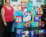 Mackenzie Hadley from the Florida Baptist Children's Homes received 2,000 diapers donated by Fist Baptist Church of Bonifay in 2015. The church also raised more than $15,000 for FBSC's Mother's Day Offering. Whitney Fowler photo.
