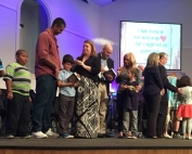 As part of First Baptist Church in Orange Park's  Generations ministry that cohesively ties discipleship with all age groups, a Rite of Passage event for second grade students held during worship included a multigenerational time of prayer and the presentation of a Bible with highlighted verses from pastoral staff, parents, grandparents and Sunday School teachers to the children