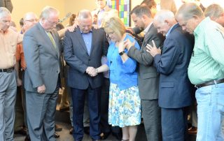 State Board of Missions members pray for newly elected executive director-treasurer Tommy Green and his wife, Karen.