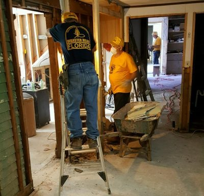 Florida disaster relief volunteers clean a flood-damaged home in Elkview, W. Va.