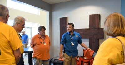 Disaster relief volunteer Micah Roden trains other volunteer Northeast Florida DR training.
