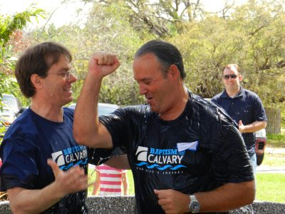 Danny Bennett, campus pastor, Calvary East Lake Church baptizes one of 100 new believers at the satellite campus.