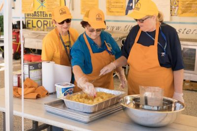 FBDR volunteers Diane Youmans of Pembroke Pines, Carol Holley of Melbourne and Beth Carr of Winter Haven, from left,  prepare to feed survivors in the aftermath of Hurricane Matthew.