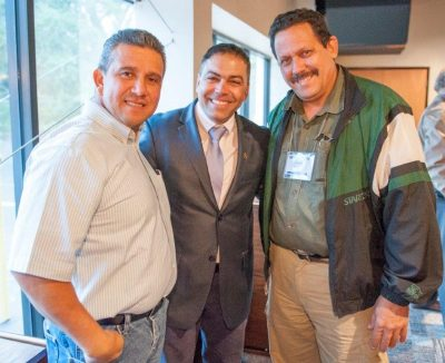 Miami pastors Juan Castro, Carlos Rodriguez and Carlos Tellez enjoy a conversation during the Hispanic fellowship meeting.