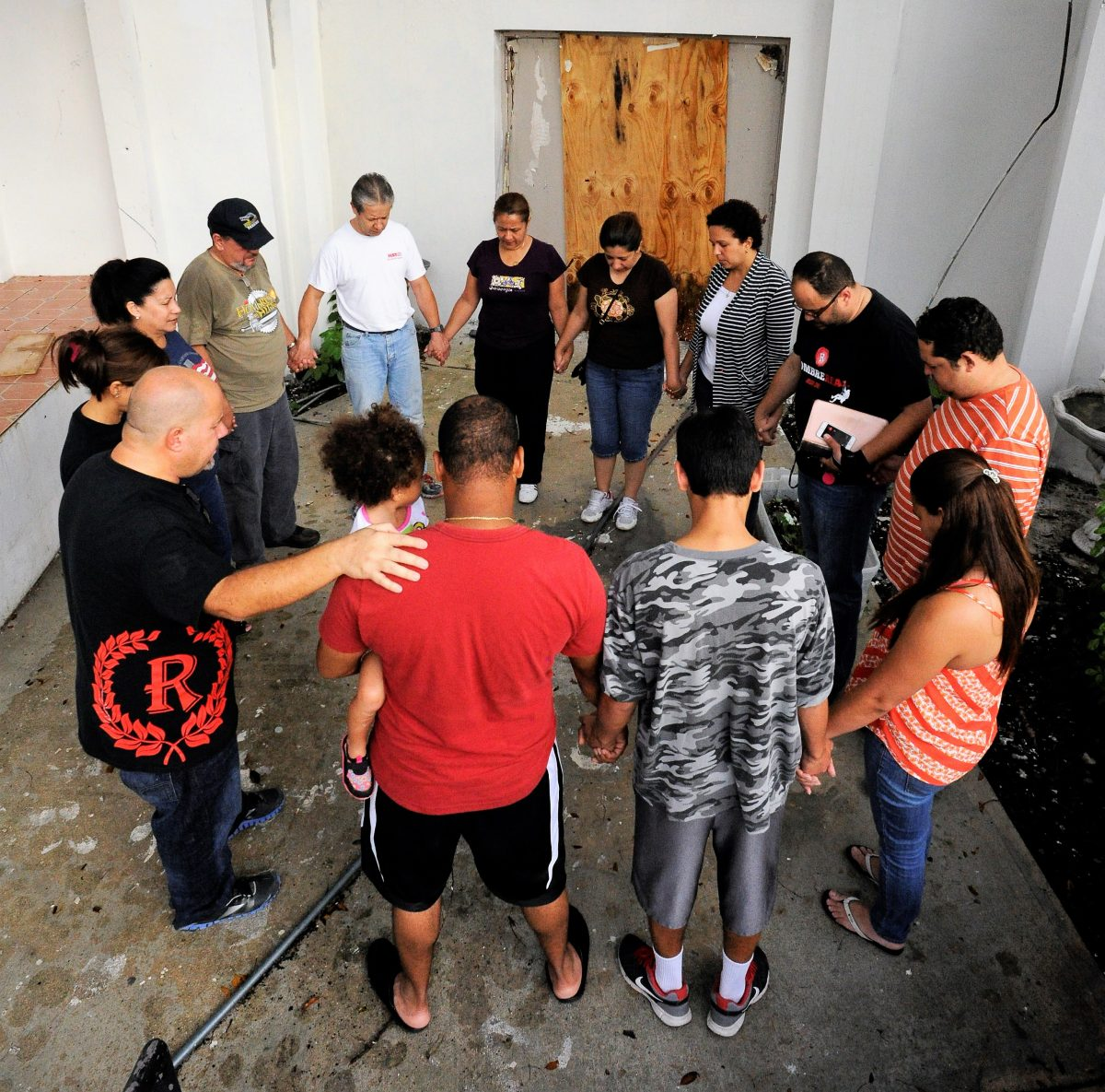Members of Igreja Real in Hollywood pray as they renovate their new property.