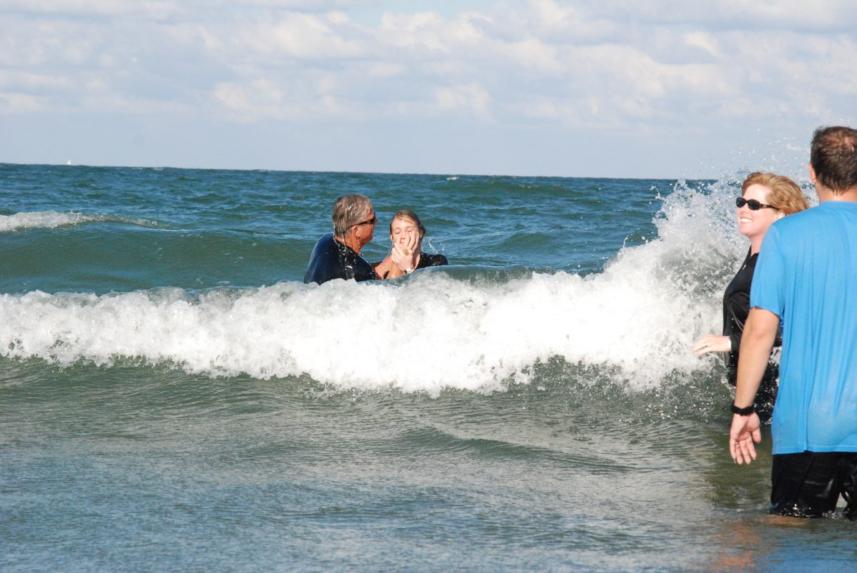 Pastor Ron Henson, MissionWay Church, baptizing new believers