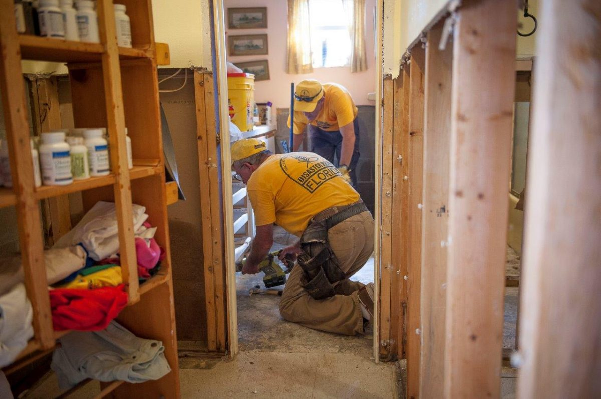 Florida Baptist disaster relief volunteers assist a homeowner in Crystal River after Hurricane Hermine.