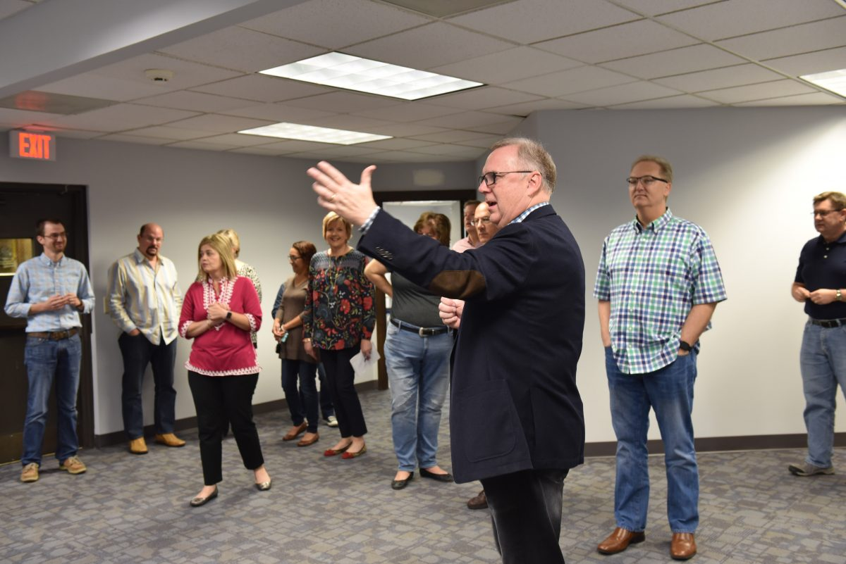 Tommy Green gives a tour of the new Baptist Building to the ministry team.