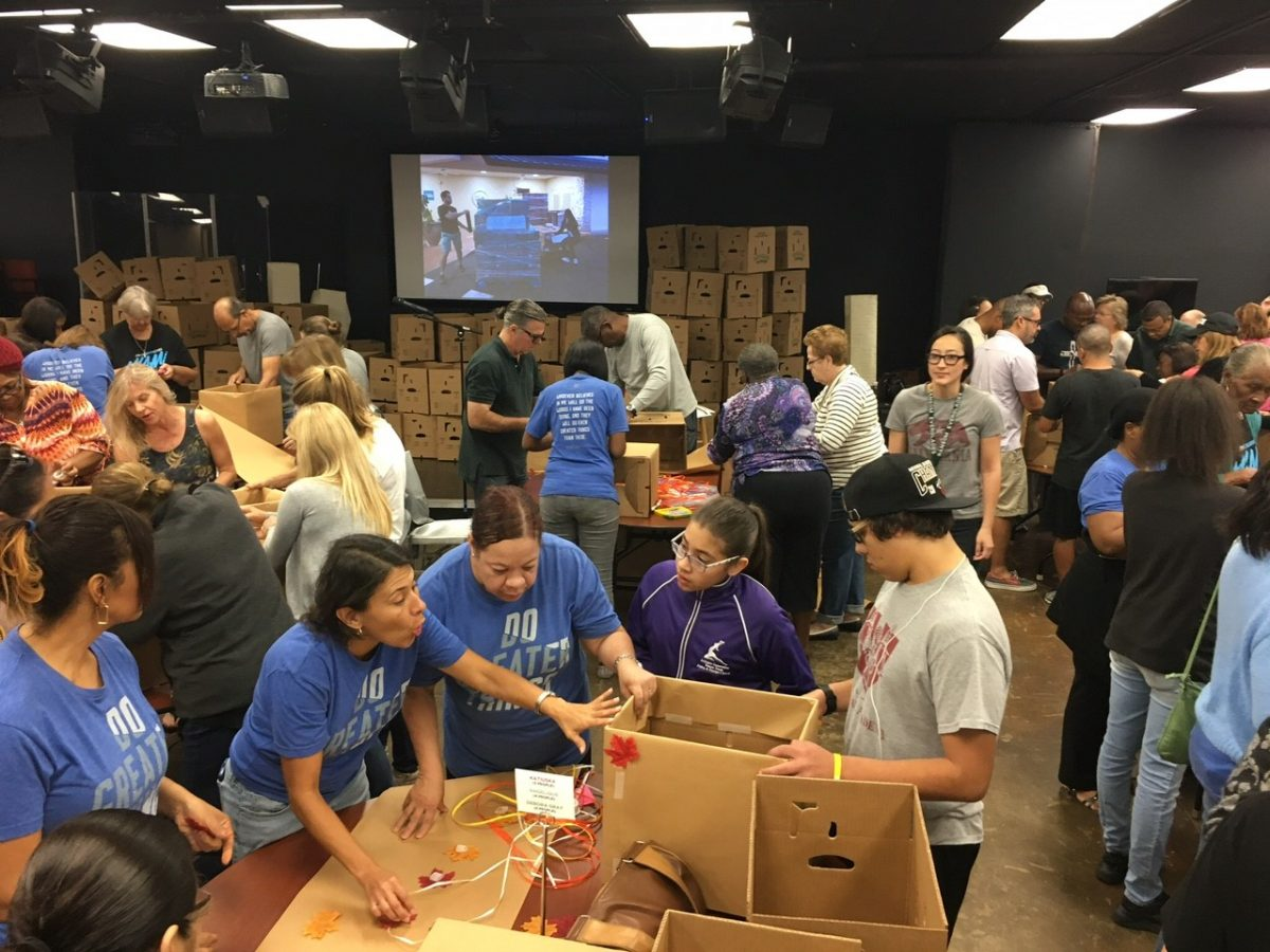 Volunteers from Christ fellowship fill 1,200 backpacks.
